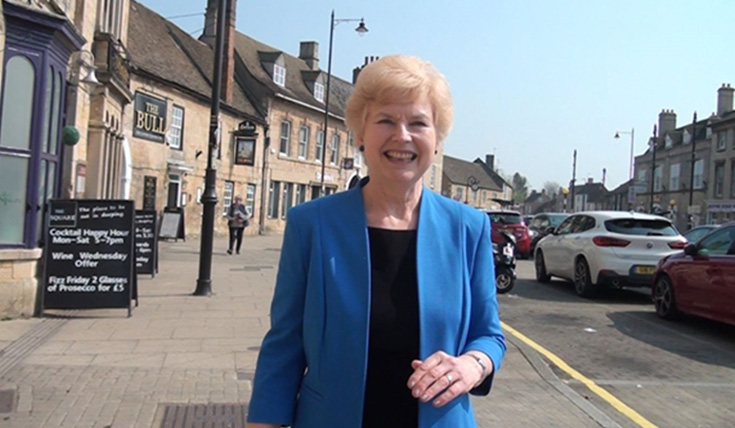 Pam Byrd in the Deepings market place, wearing a blue jacket.