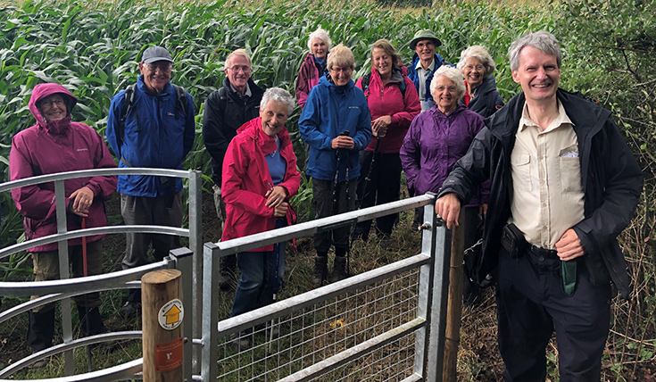 Chris Rich and the South Wiltshire Ramblers stand beside the donated kissing gate.