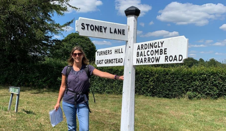 Helen Grover with signpost