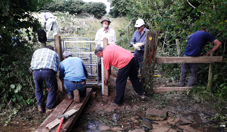 A team of men installing a gate