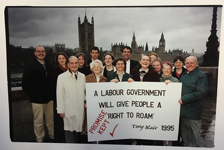"Protestors on the Thames with a sign ""A Labour Government will give people a right to roam"""