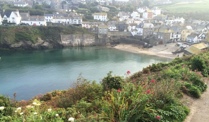 A view of Port Isaac from above - a bay with houses overlooking it