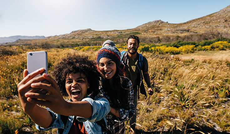 Group of people taking a selfie on a walk.