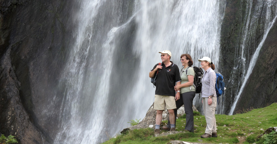 Walkers at a waterfall
