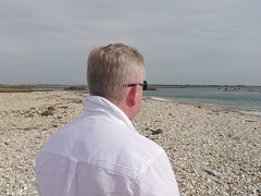 Walking Class Hero looking out to sea