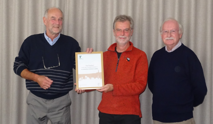 Three men and a Ramblers commendation certificate