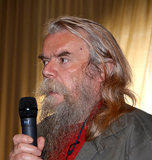 A man speaking in to a microphone