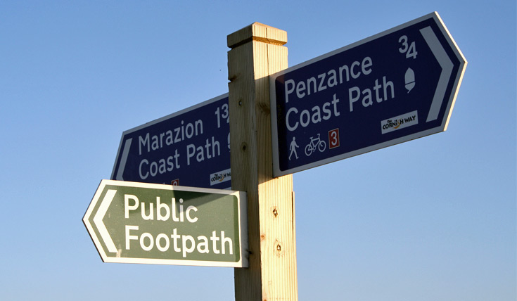 3 directions on a path sign