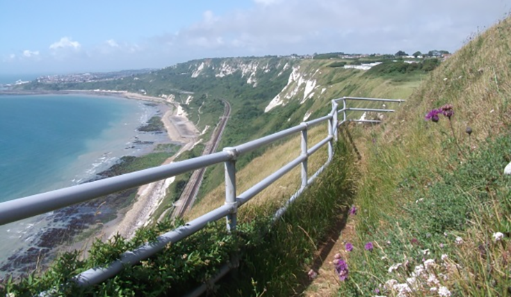 View down cliffs looking at railway line