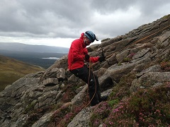 Dom abseiling in the Cairngorms