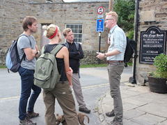 Walkers in conversation with Ramblers CEO Benedict Southworth in Edale