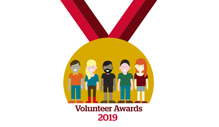 "Illustration of a medal showing five people and the text ""Volunteer Awards 2019"""