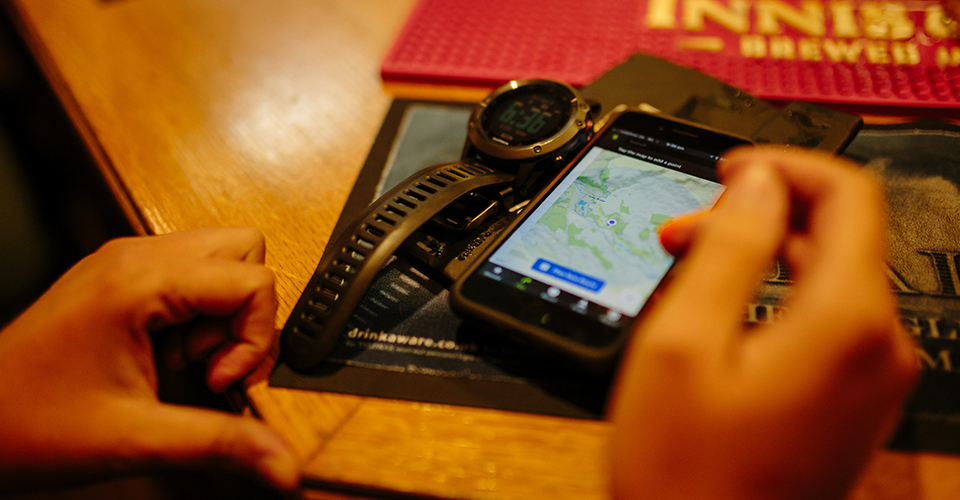Indoor image of a phone showing a map, sitting on table