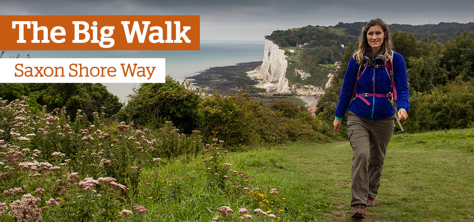 The Big Walk: A woman walking along a cliff path
